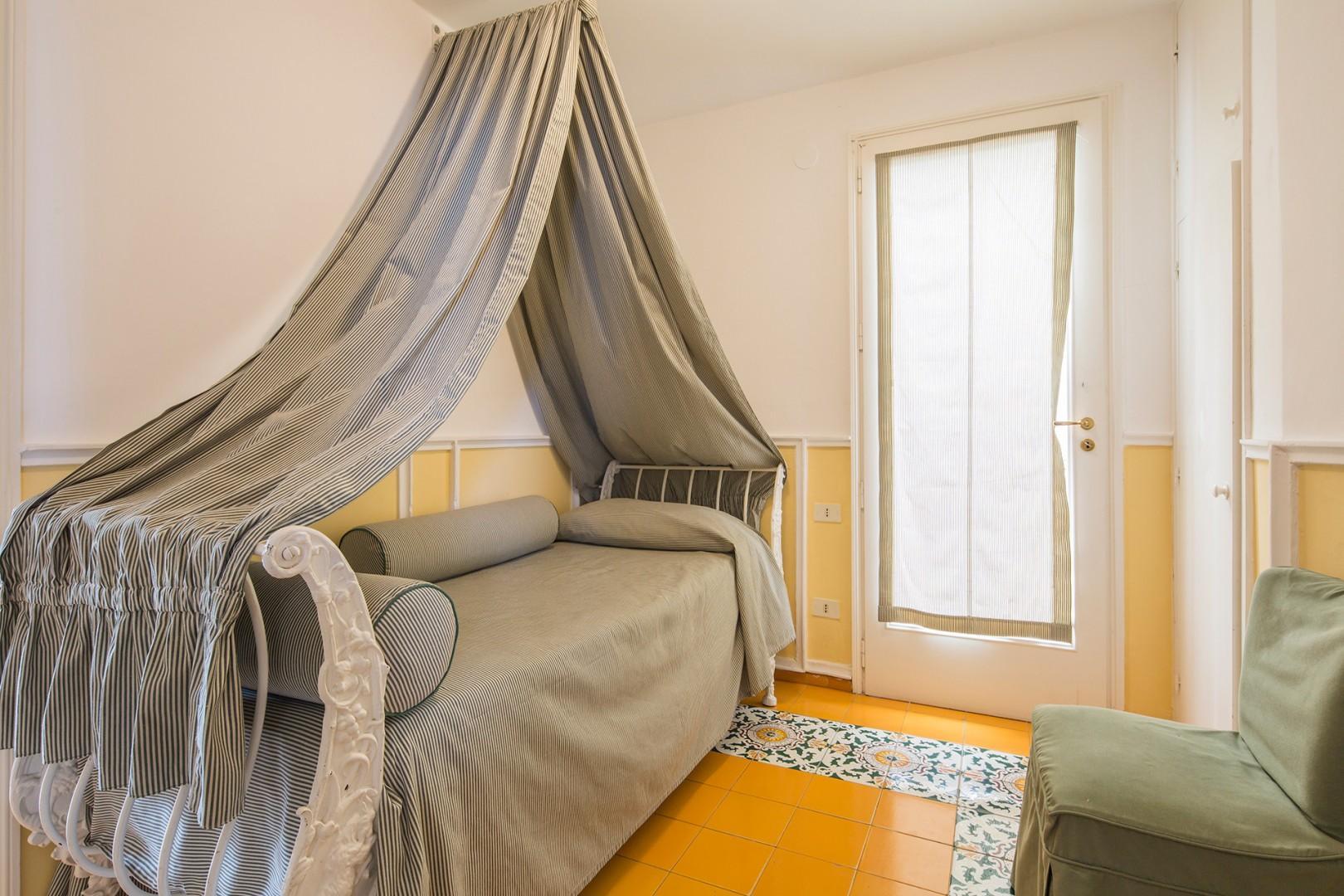 Small bedroom 2 on the main floor. Door opens onto the pool terrace.