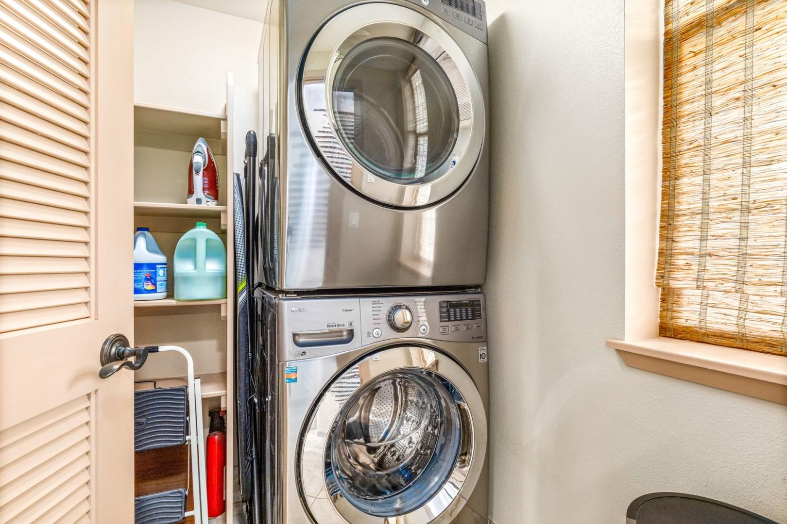 Dedicated laundry room with oversized washer and dryer and supplied detergent.