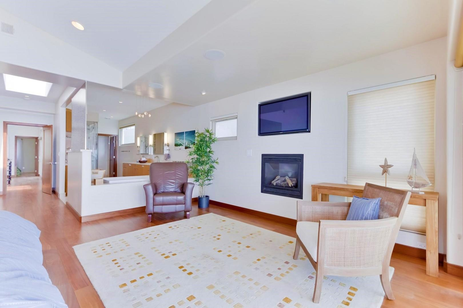 Master suite fireplace and flat screen TV