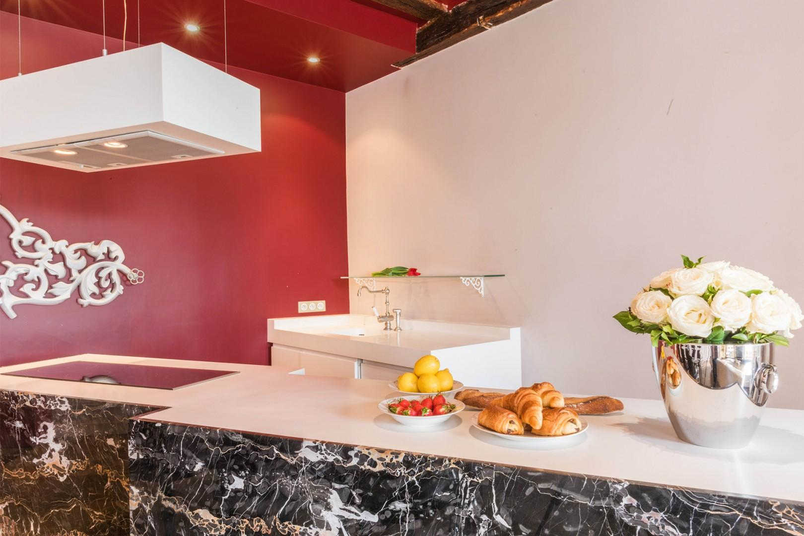The cleverly designed kitchen keeps everything neatly out of sight.