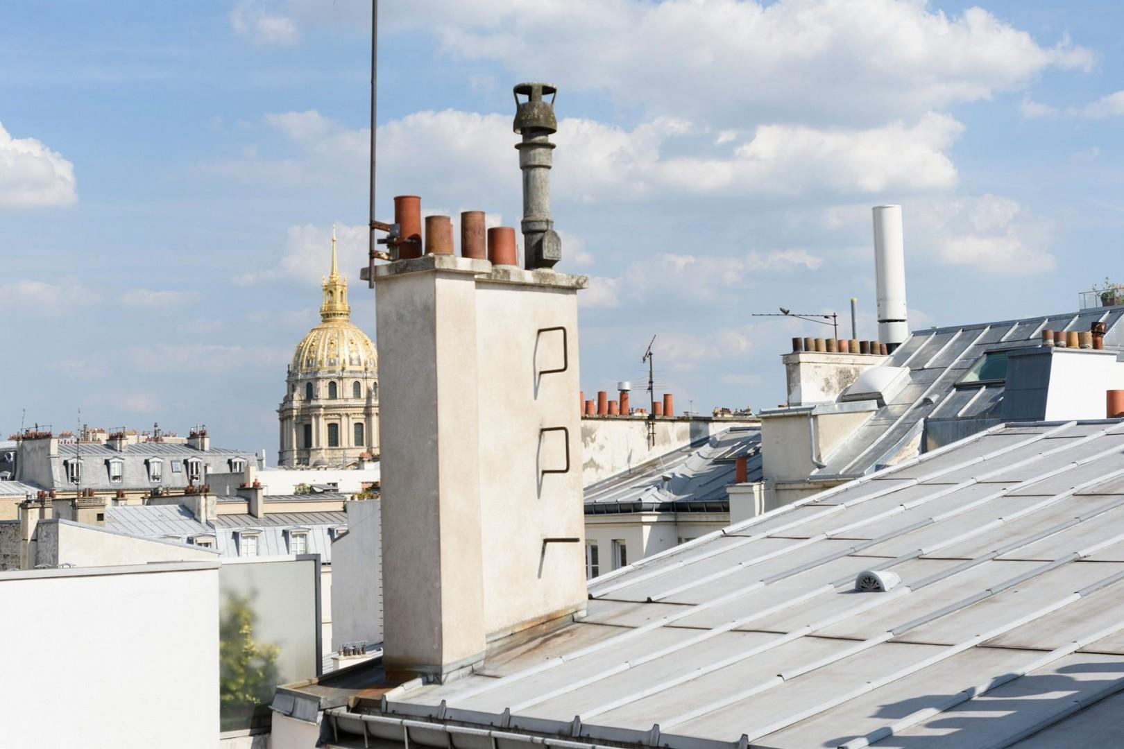 Enjoy the view of Parisian rooftops and Les Invalides.