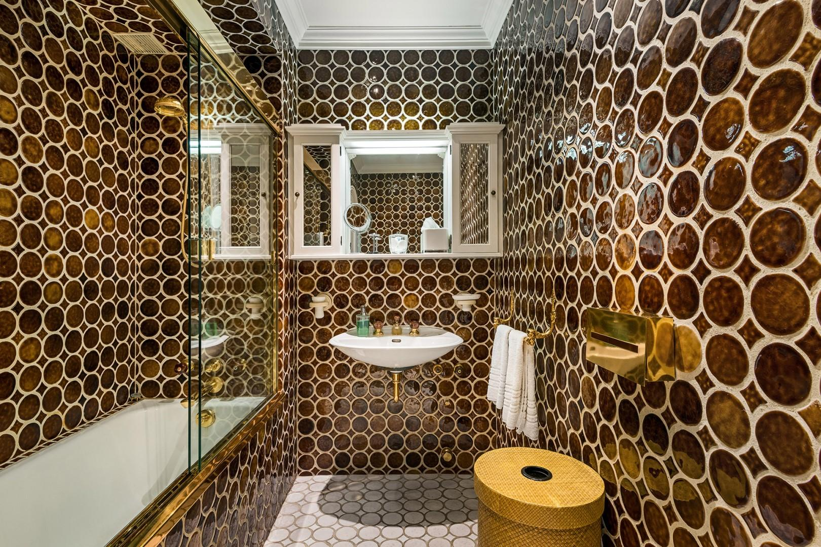 The designer bathroom 2 features one-of-a-kind tiling.