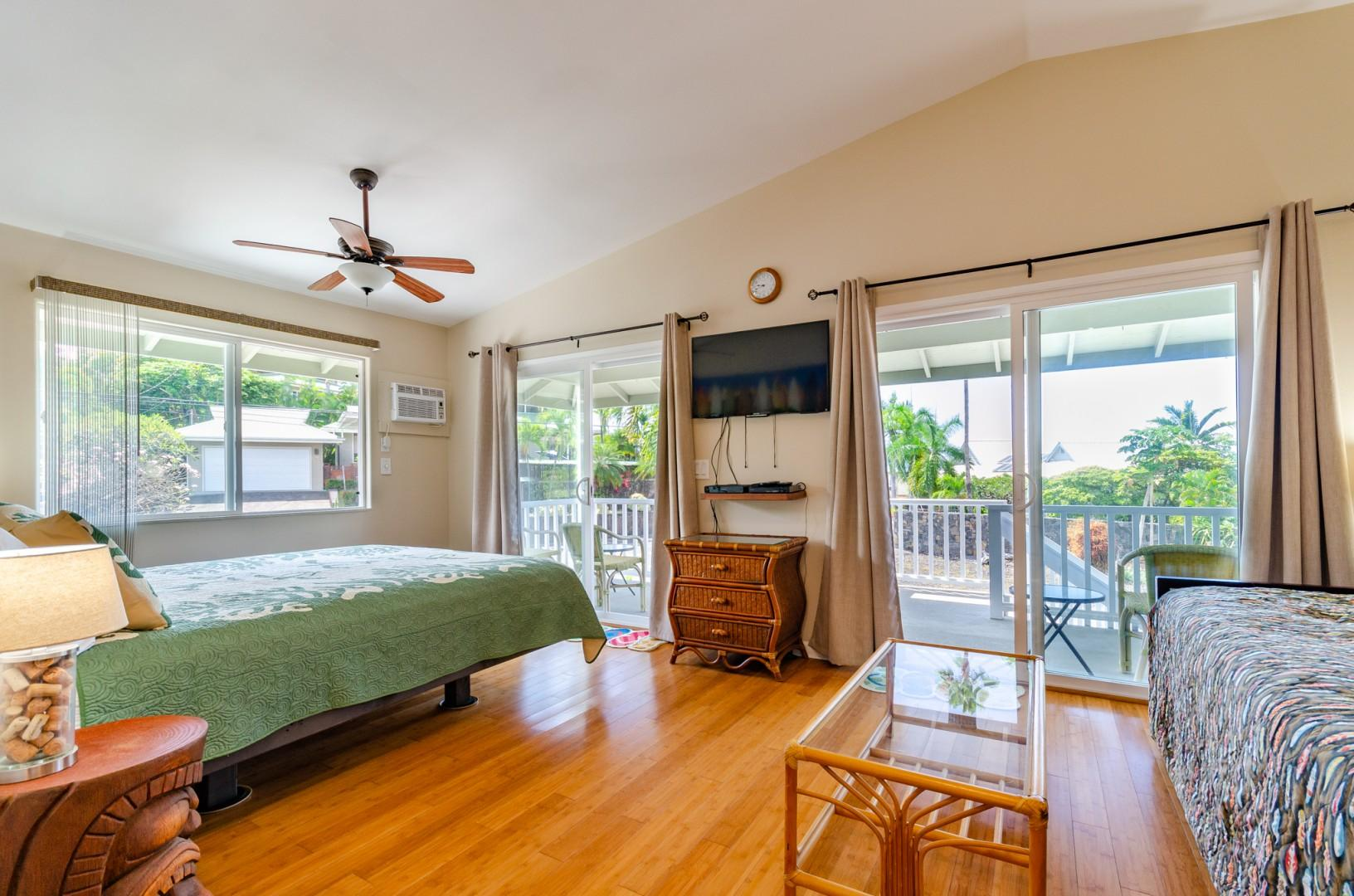 Master bedroom equipped with TV, A/C, and Lanai access