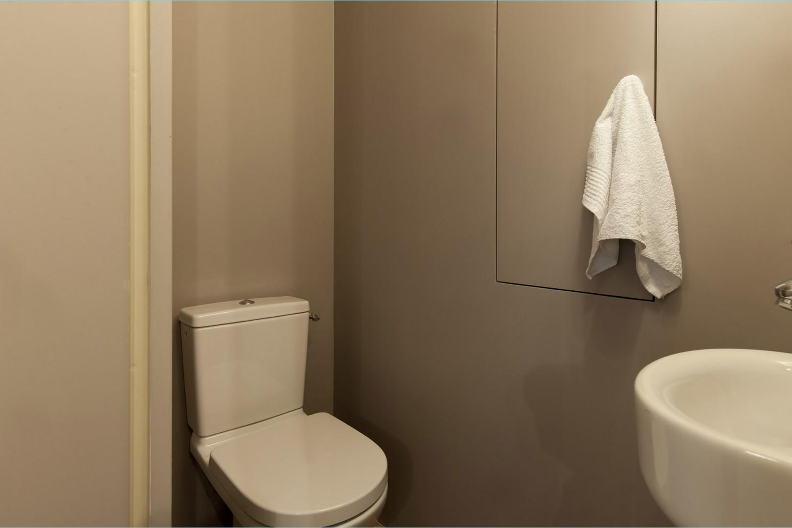 There is a practical separate half bath with a toilet and sink.