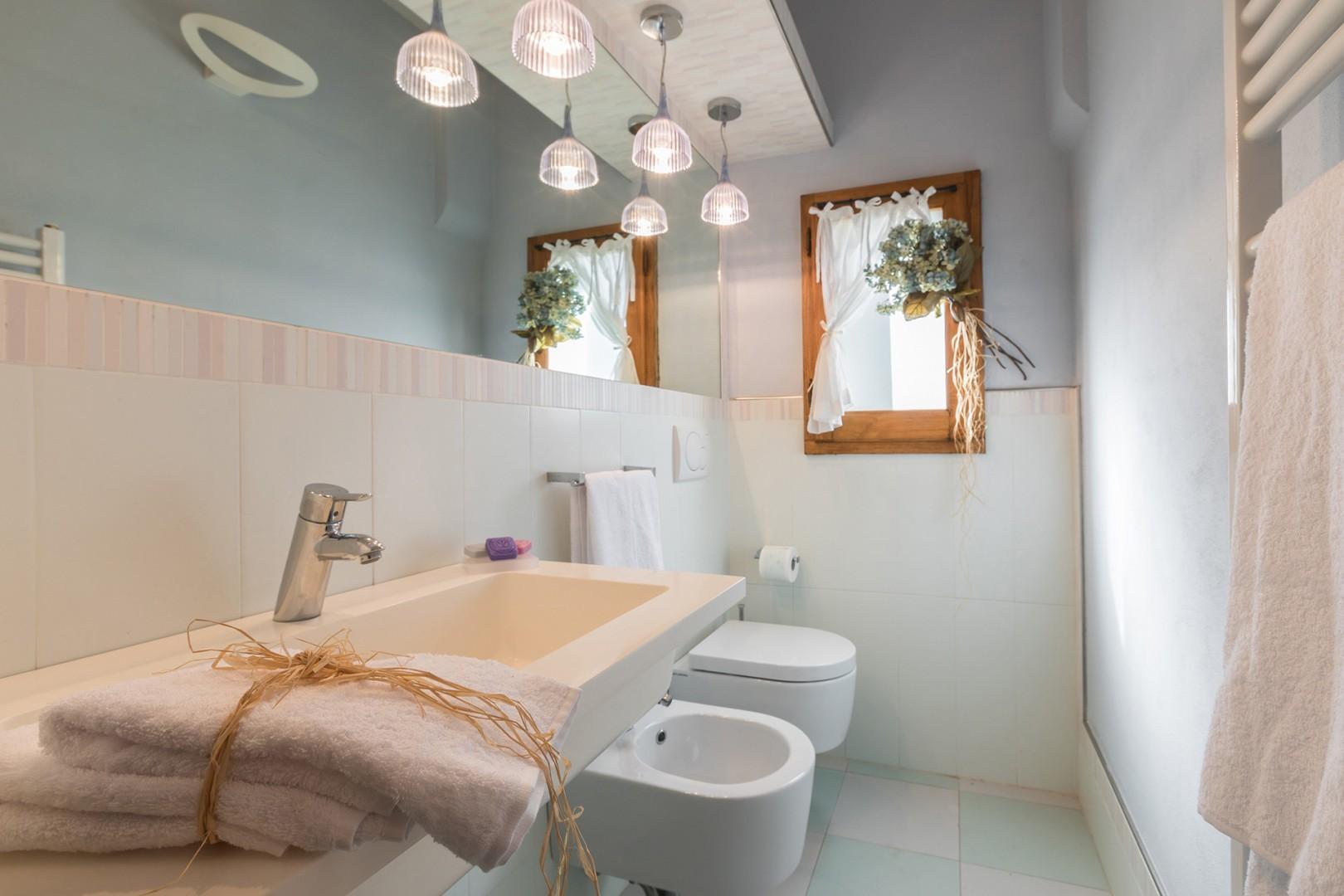 En suite bathroom to bedroom 2.