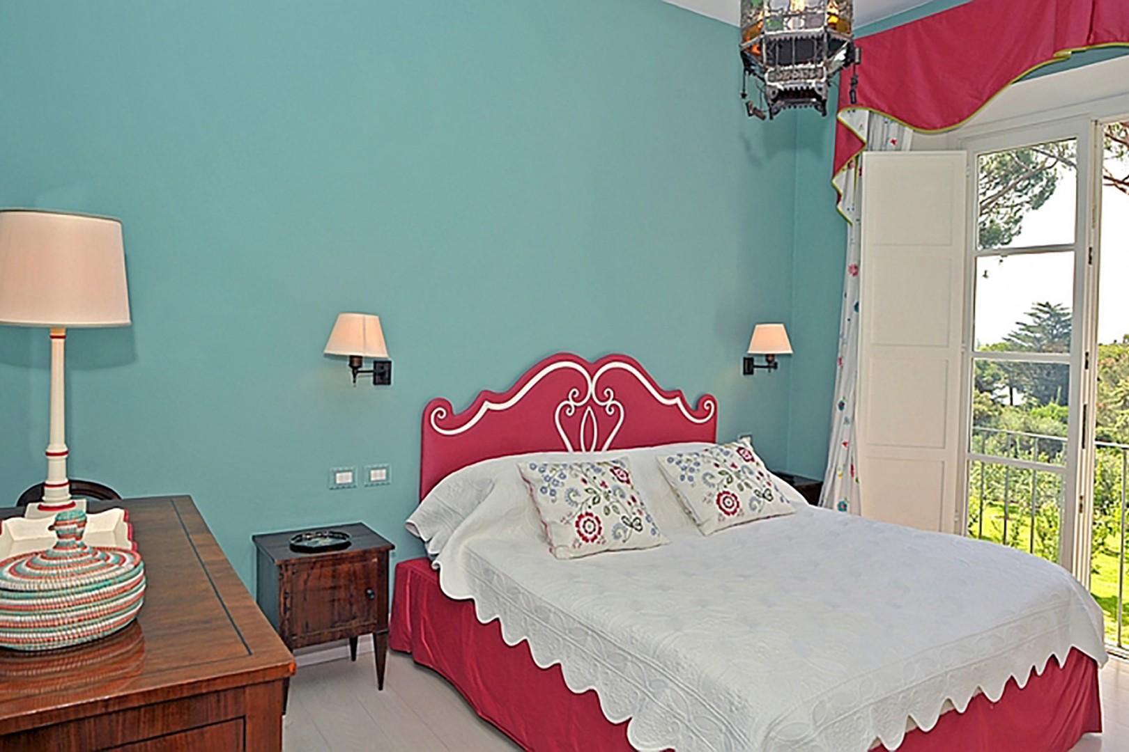 Bedroom 5 with en suite bathroom and balcony access.