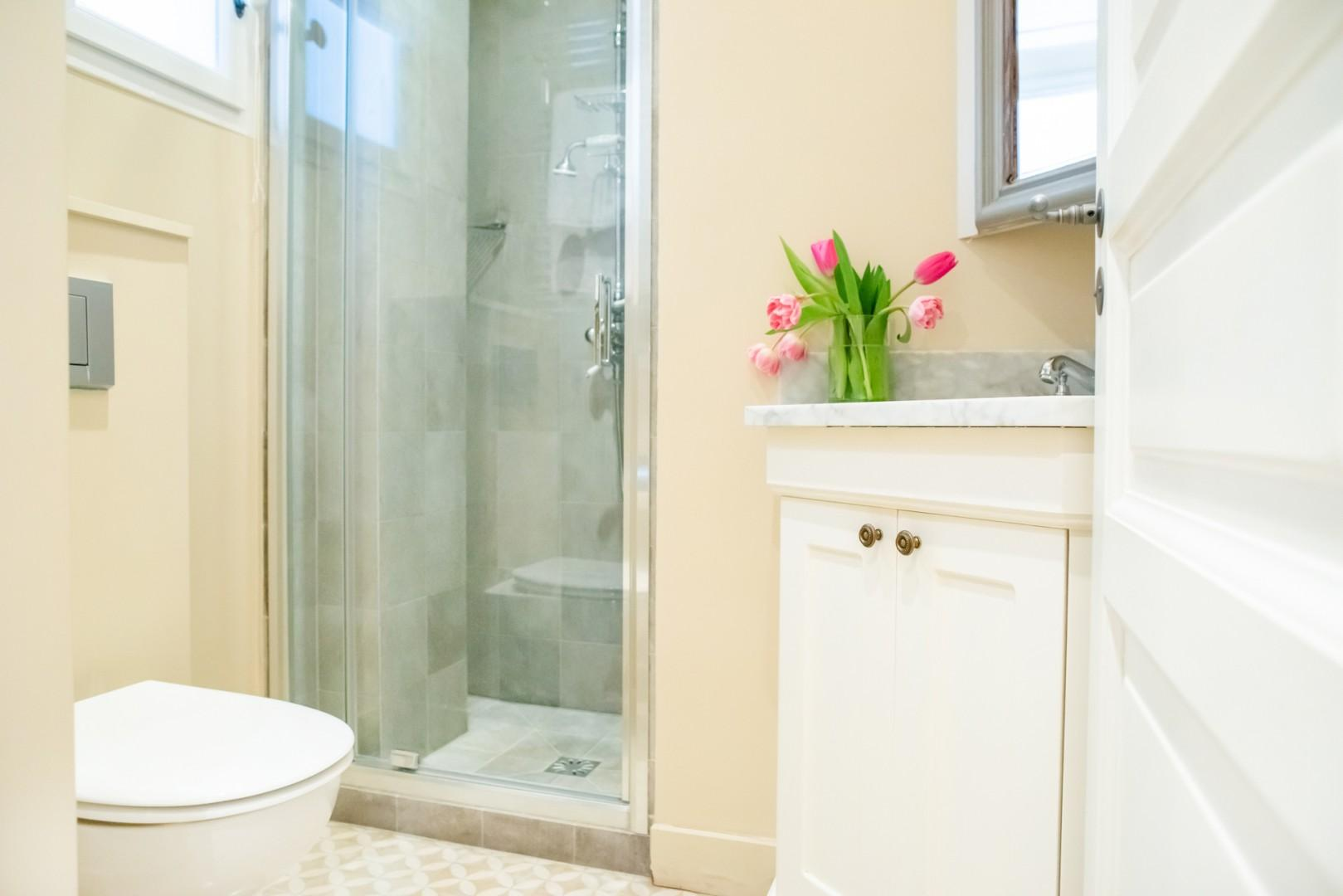 Next to bedroom 2, you'll find a separate bathroom with a shower and heated towel rack.