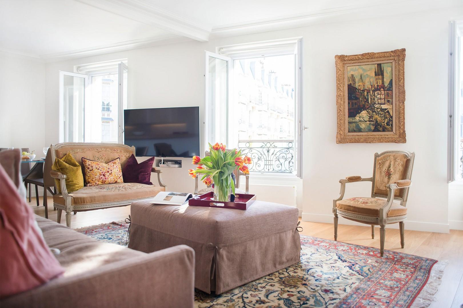 The apartment has been decorated with a mix of antiques and modern furnishings.