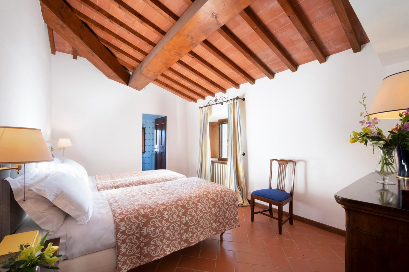 Bedroom 3 has two beds that can be joined together and an en suite bathroom.