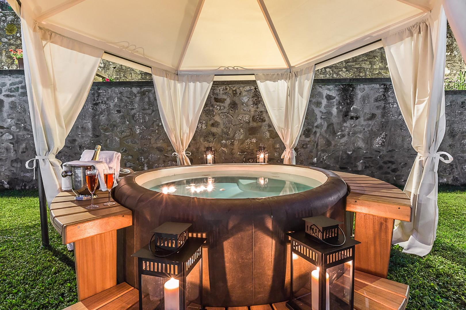 Relax and revitalize in the outdoor Jacuzzi.