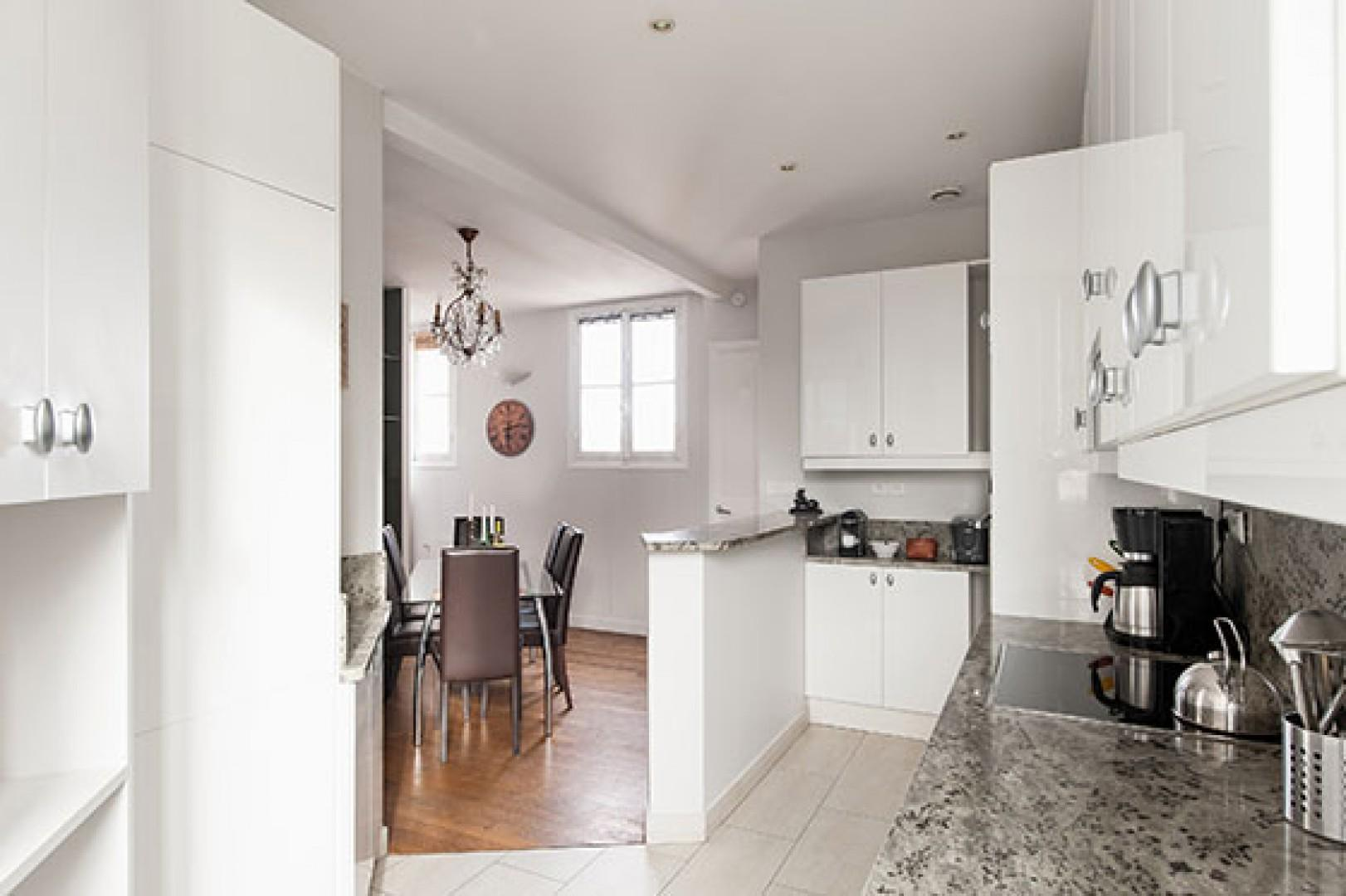 The beautifully designed open-plan kitchen and dining area is great for entertaining.