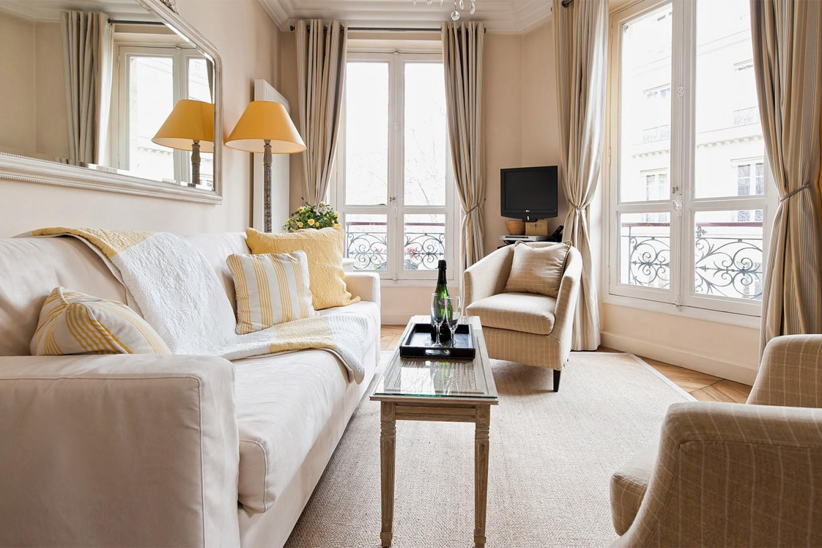 The spacious and elegant apartment is decorated in a charming, elegant French style.