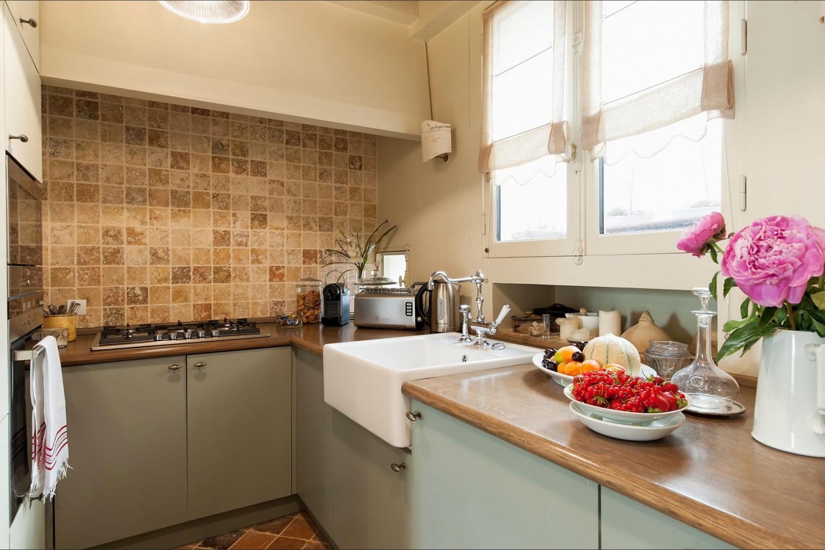 Enjoy preparing meals in this lovely kitchen with modern appliances.