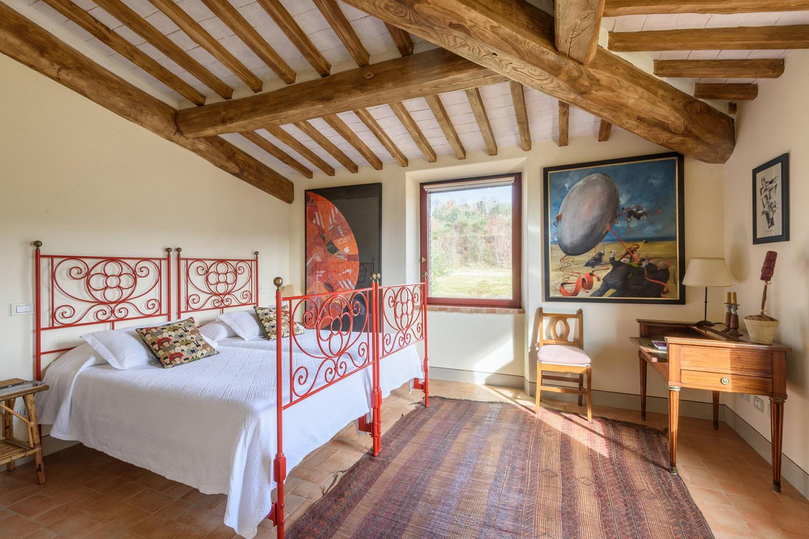 Two beds in bedroom 2 which has beamed ceilings and bucolic views.