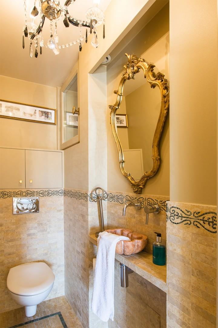 Separate half bath with a toilet and sink