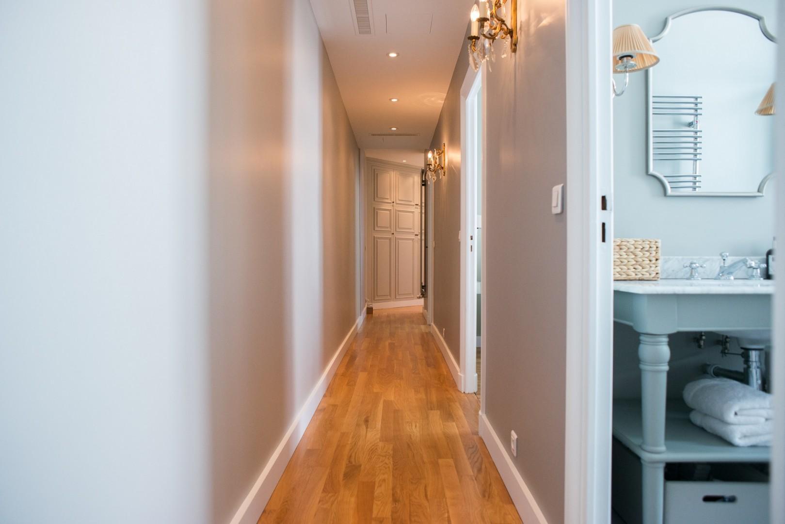 Long hallway with original oak flooring