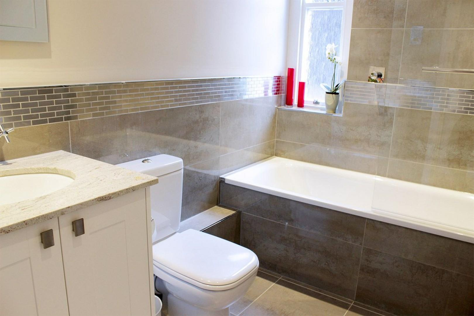 Bathroom with bathtub & shower combo, toilet and sink
