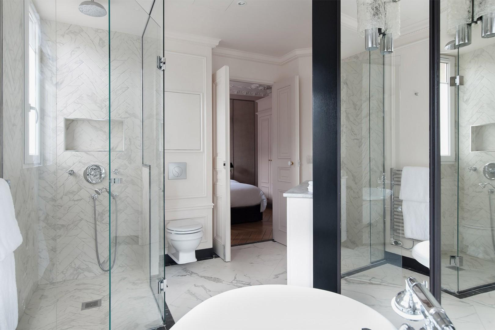 Enjoy the large shower with fixed and flexible shower heads in the en suite bathroom.
