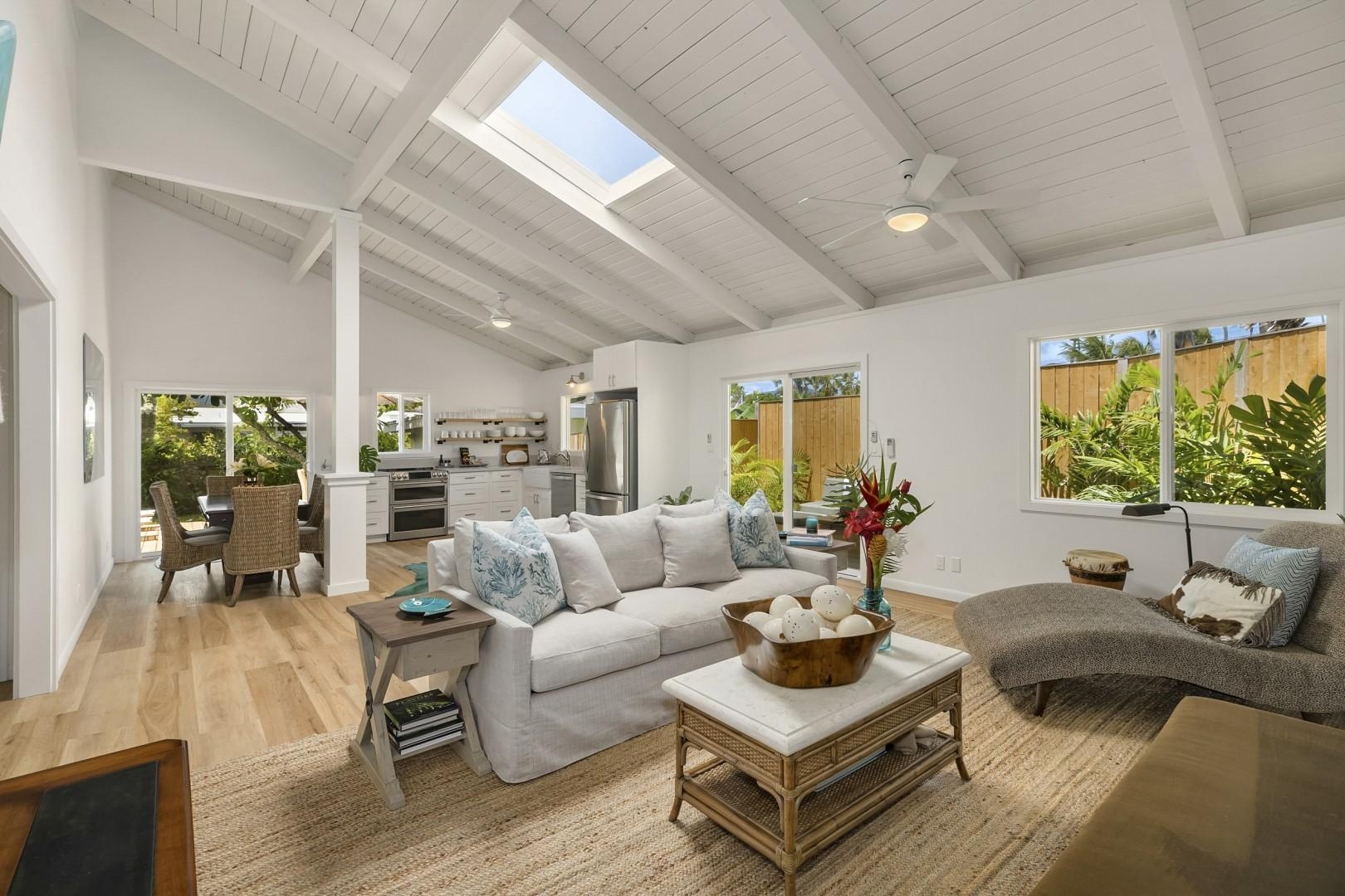 Open floor plan with Vaulted Ceilings and Skylight
