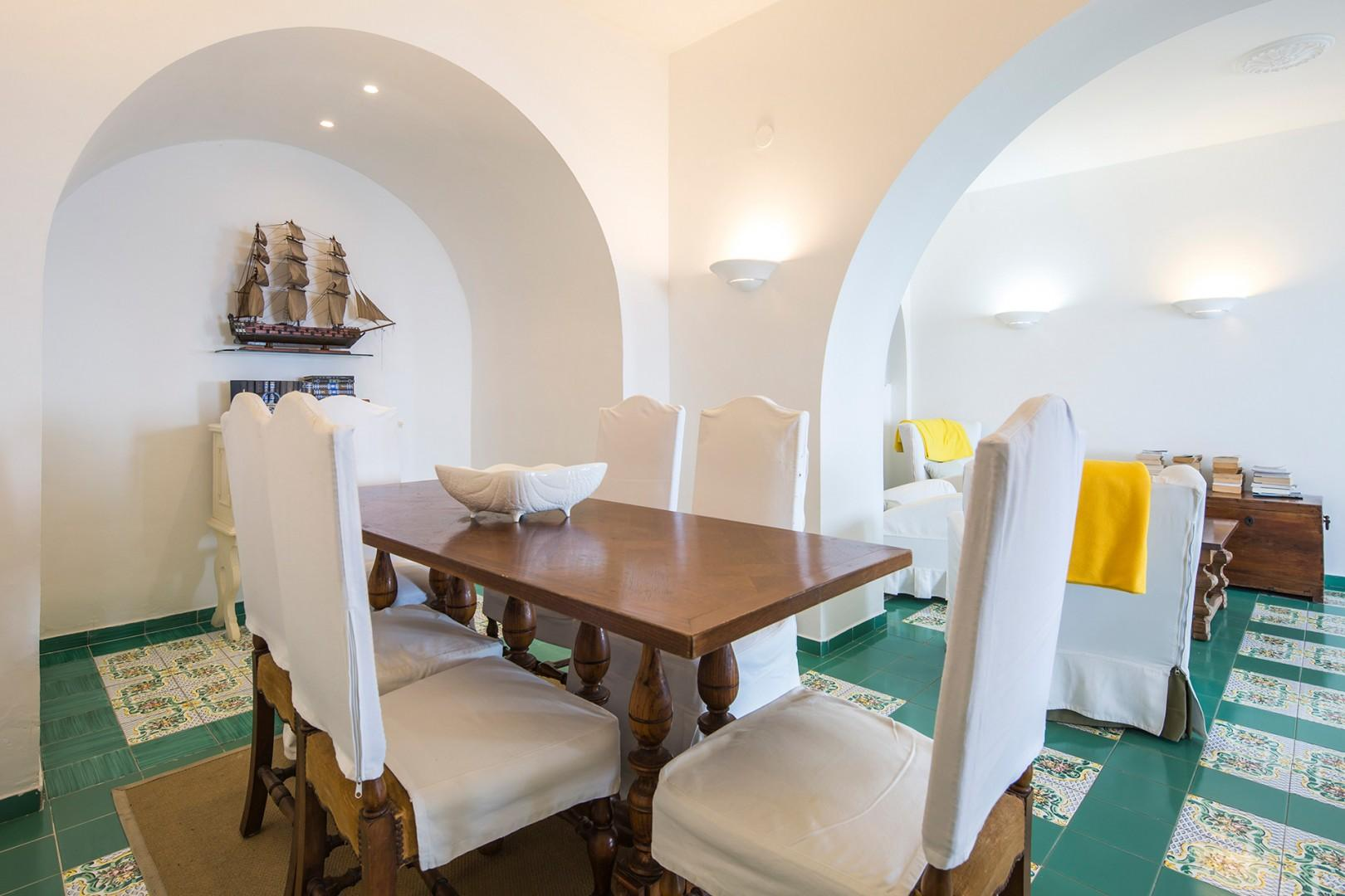 The dining area is open to the living room. Dining table seats 6, comfortably.