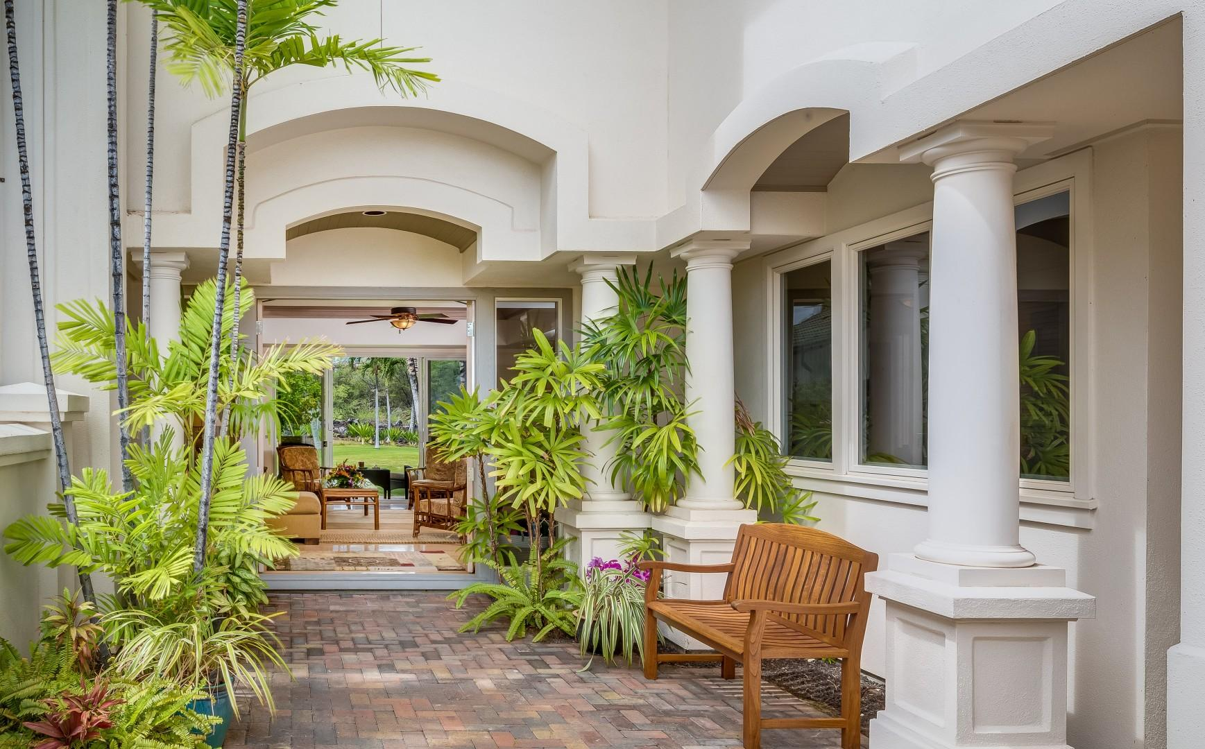 Beautiful Courtyard Leads Into Living Room and Out Into Gardens