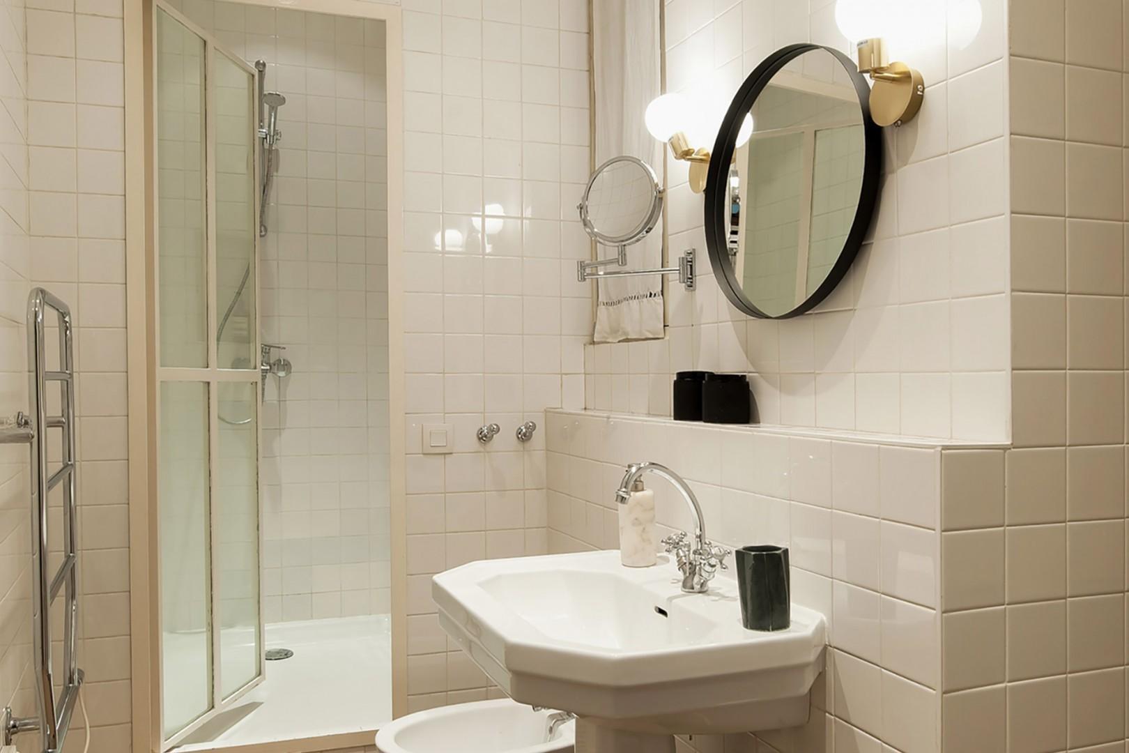 Bathroom 1 featuring a bathtub, shower, sink, toilet and bidet