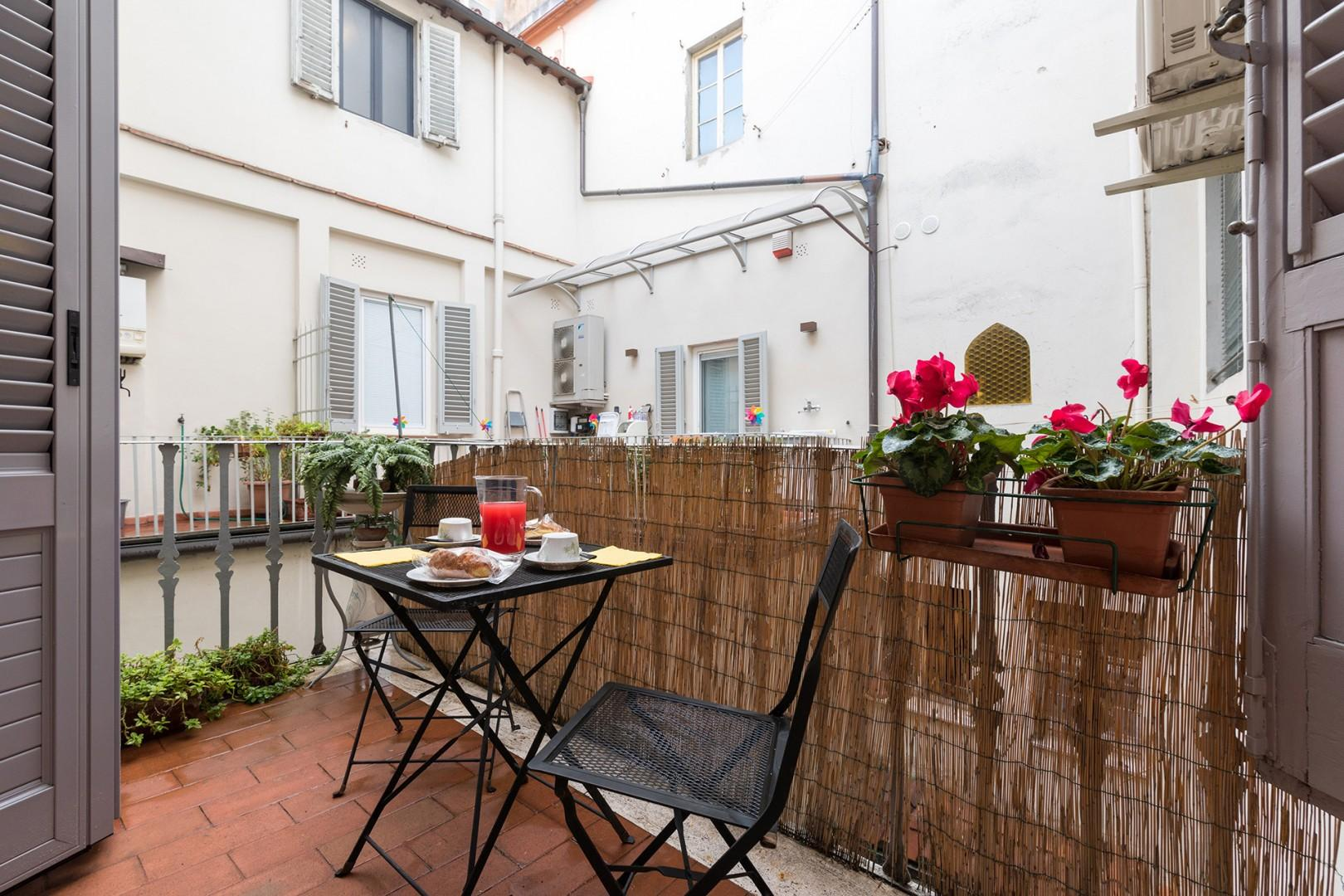 The small terrace provides a sunny retreat. It faces the back of the neighboring apartments.