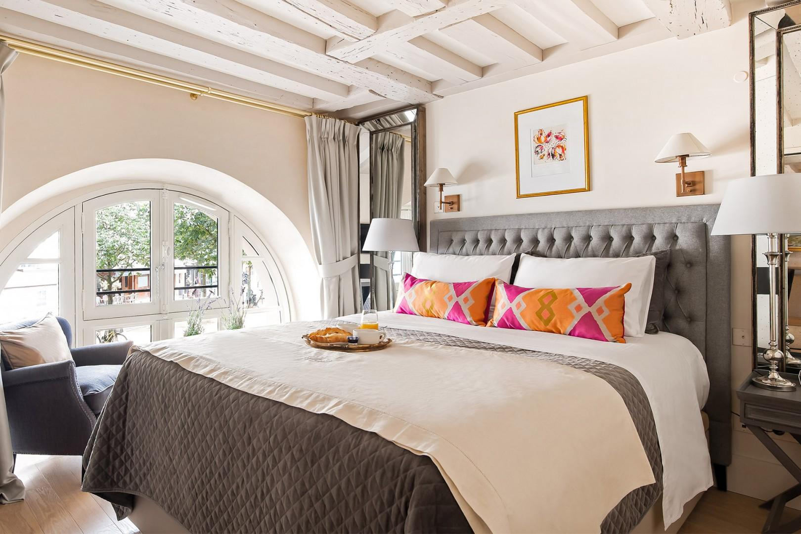 Enjoy the sumptuous bed and tasteful décor in bedroom 1.