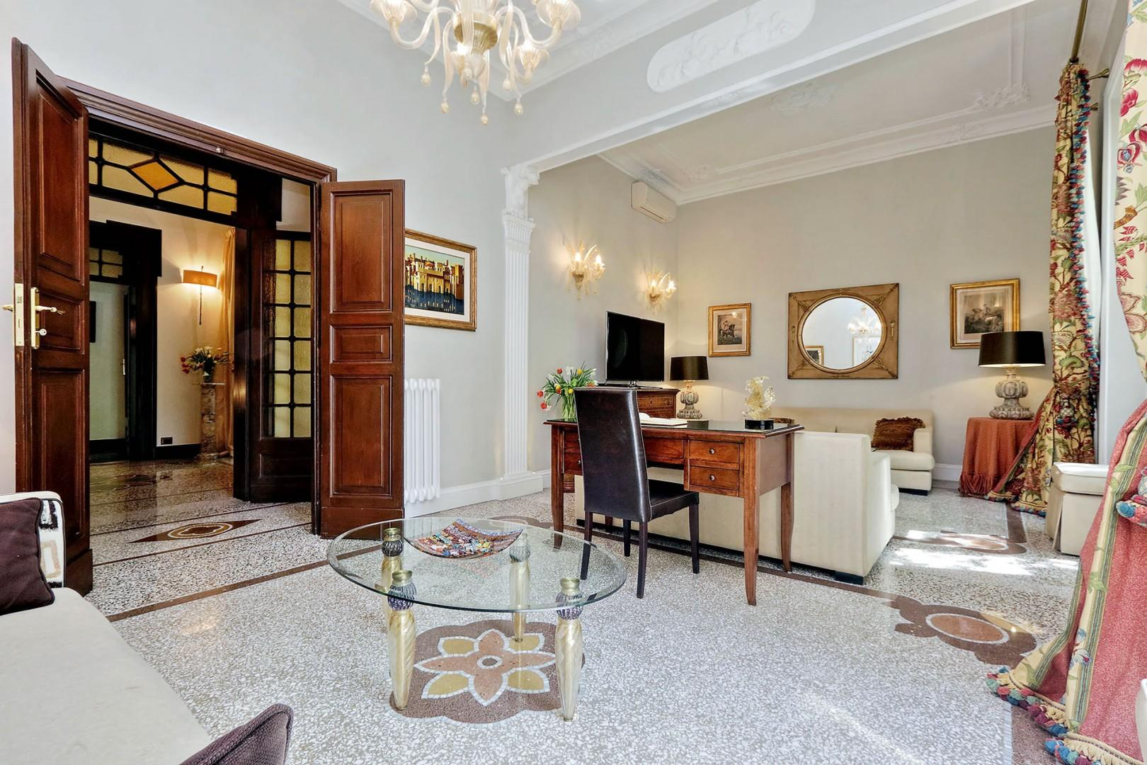 There are two seating areas in the living room of this elegant, tastefully appointed apartment.