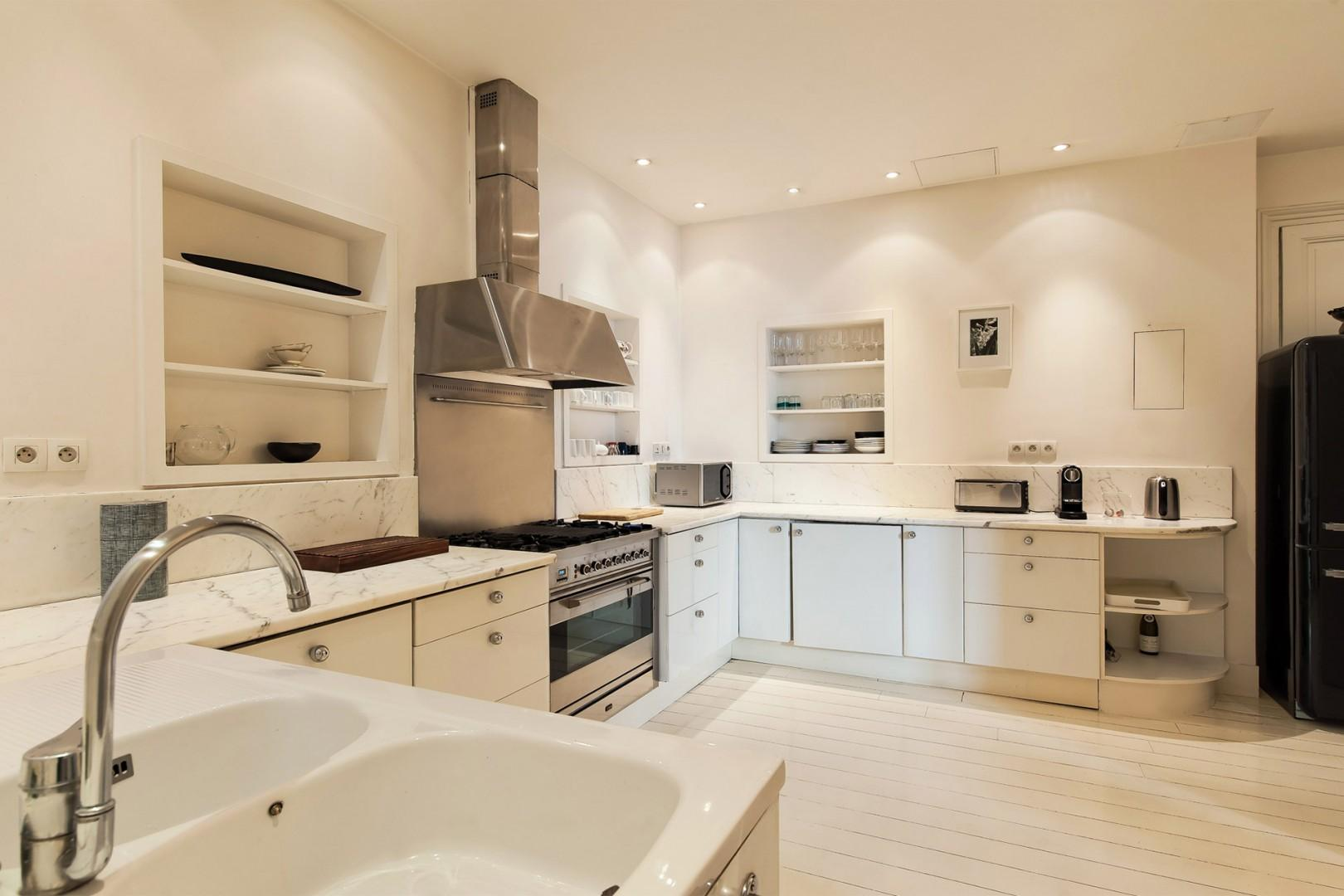 The large kitchen has modern appliances plus everything you need to cook at home.