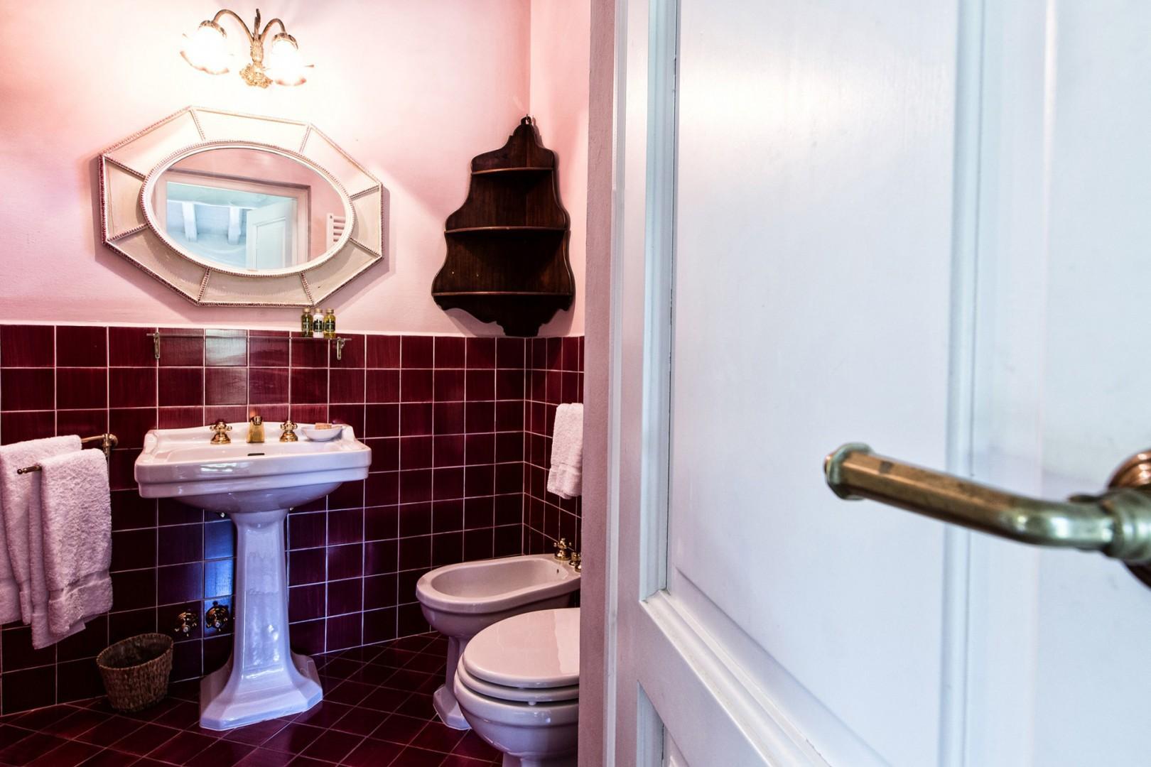 En suite bathroom 2 with shower, sink, toilet, and bidet.