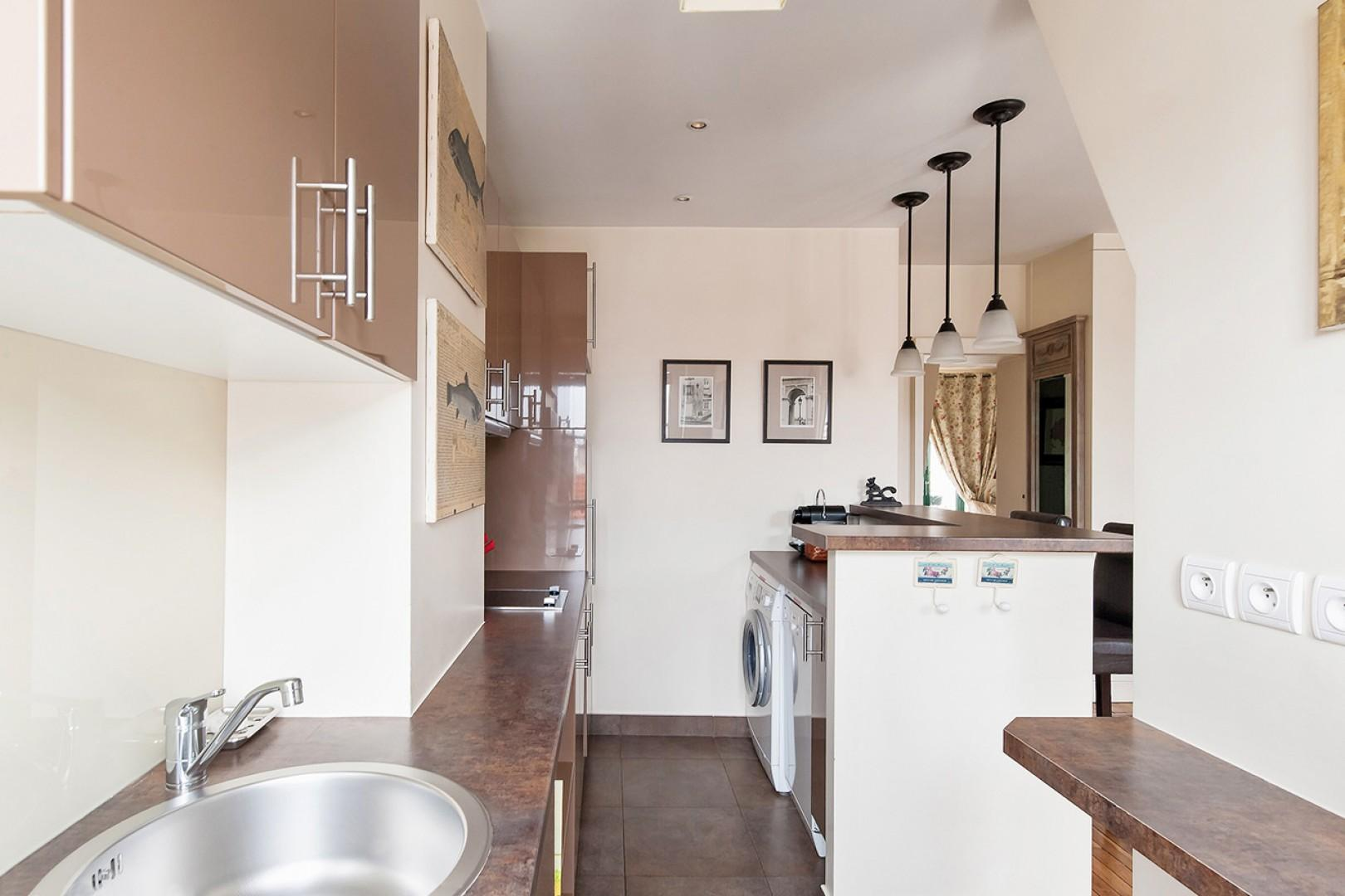 The kitchen is fully equipped and there is plenty of workspace.