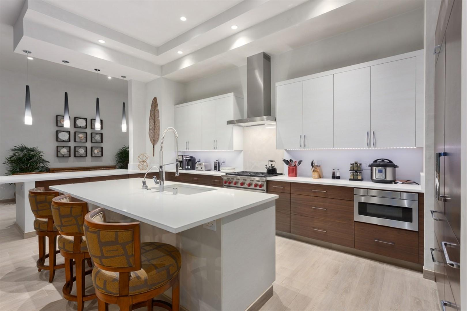 Gleaming top tier appliances in this fully equipped kitchen - a chef's delight!