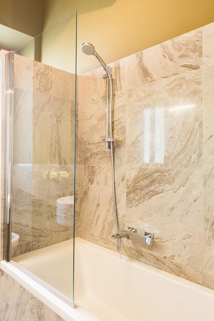 Raise or lower the shower height, based on your preference.