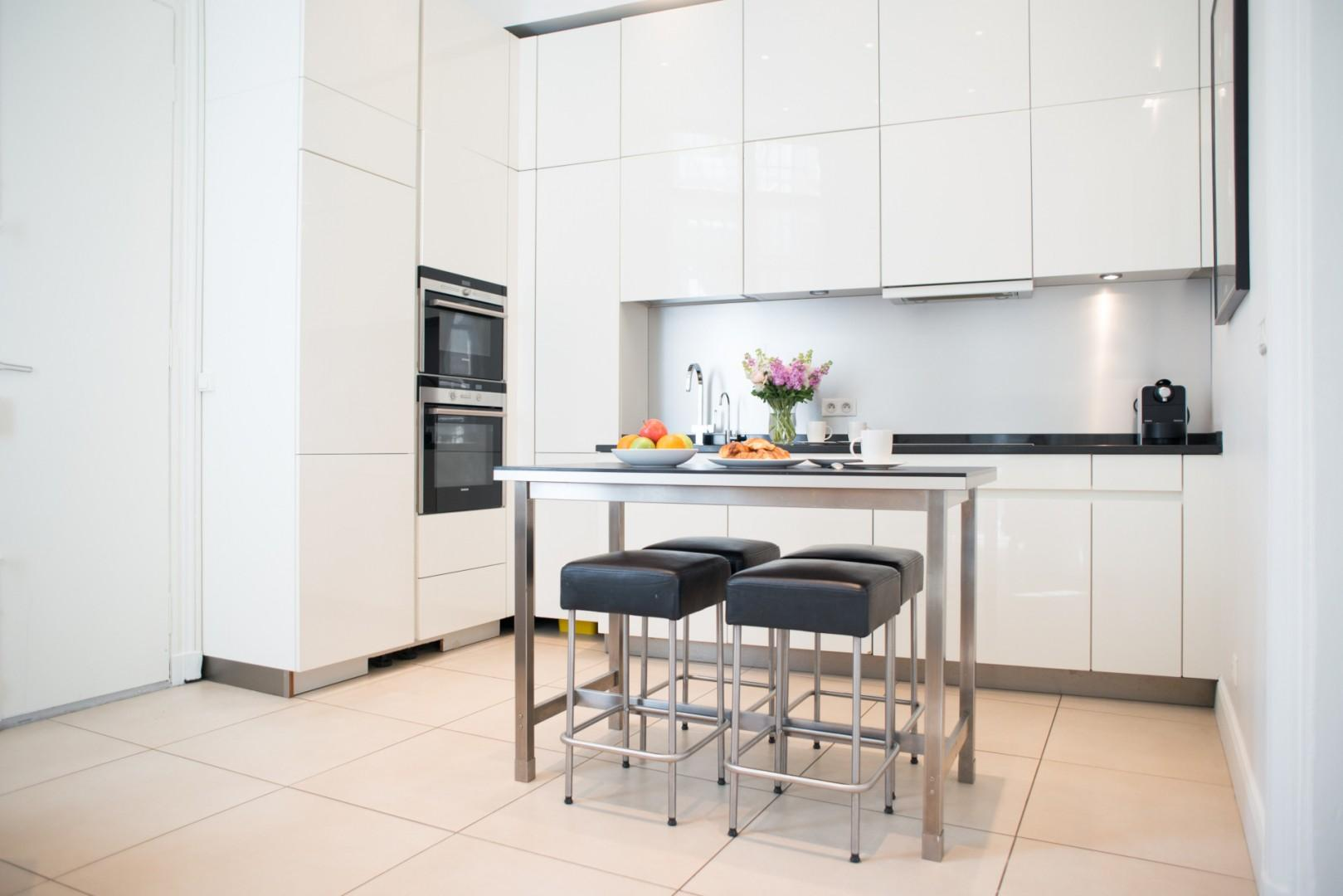 The beautiful modern kitchen is just off the living room.