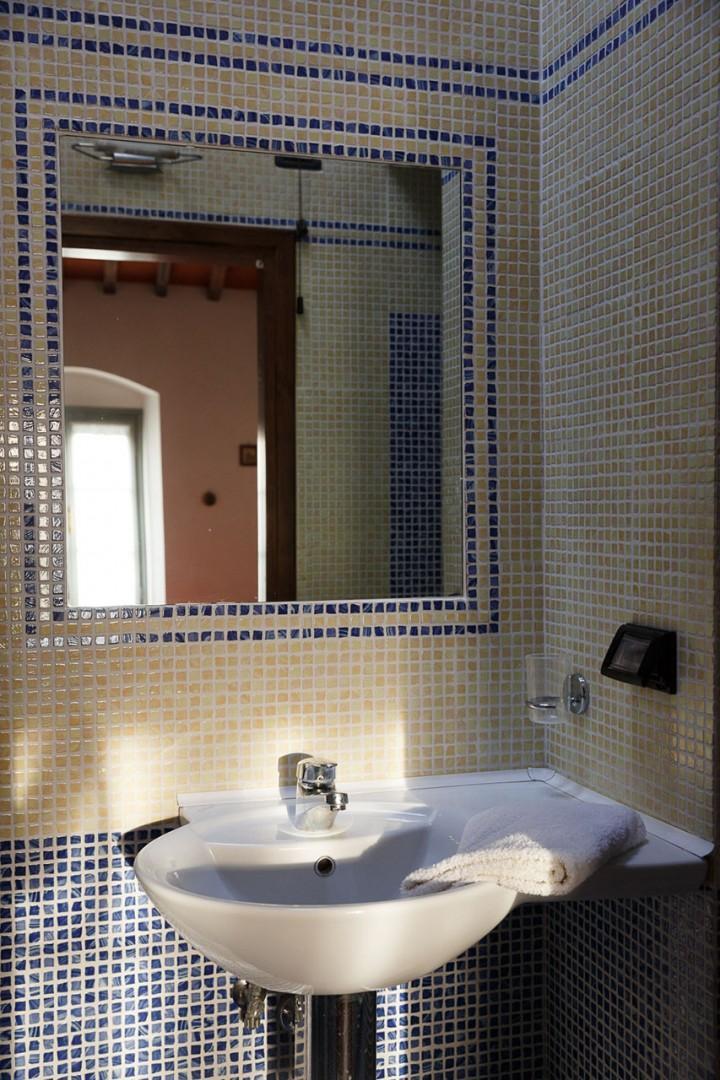 Bathroom 2 has a toilet, shower, sink and bidet.