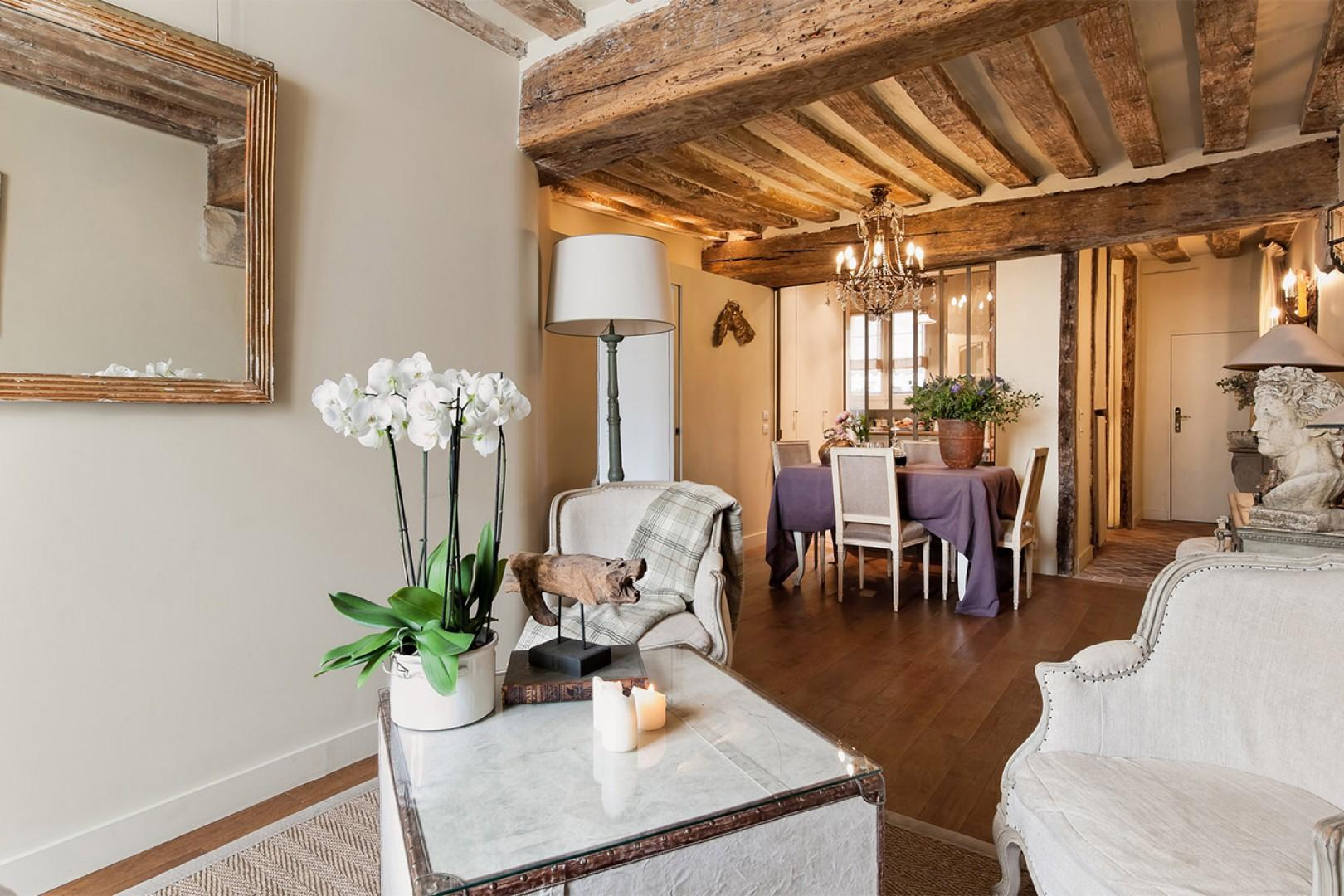 The stunning apartment features original elements, such as wooden beams.