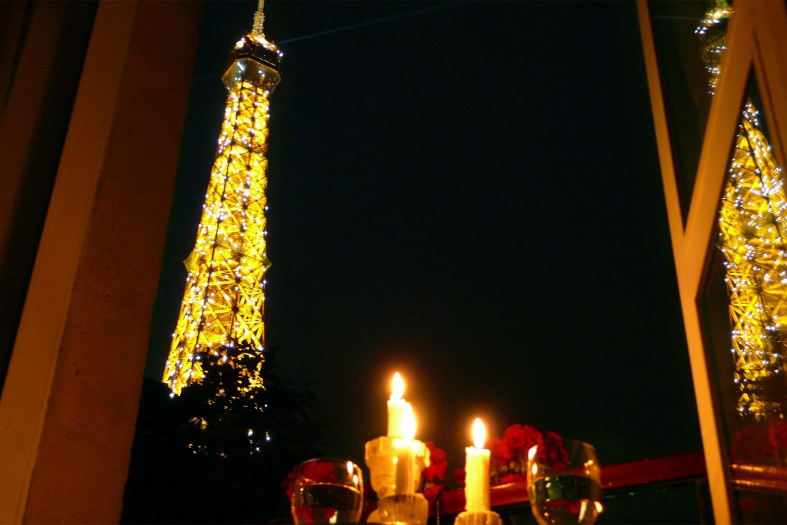 Marvel at the Eiffel Tower lights from your Paris rental!