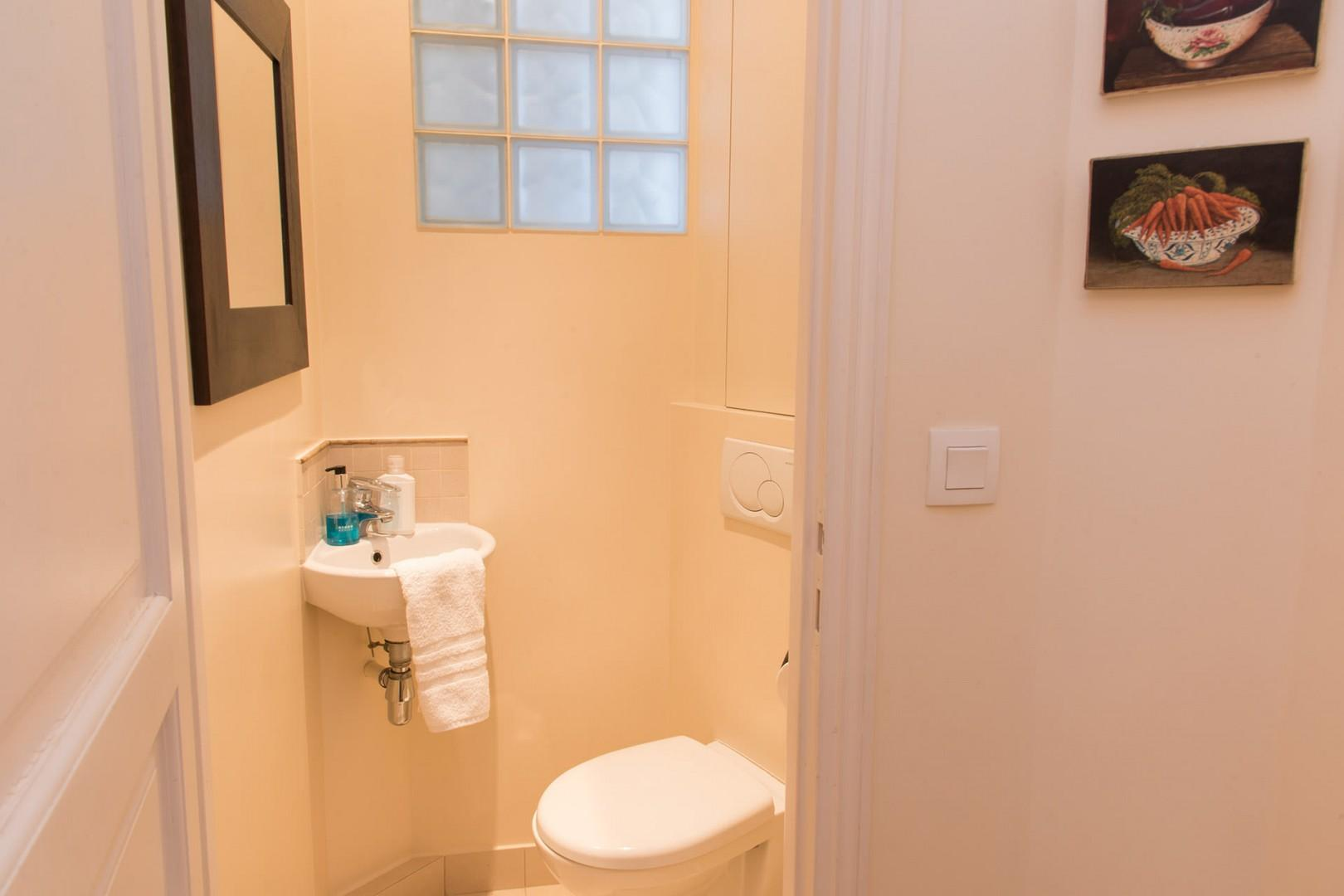 For added privacy, there is a separate half bath with toilet and sink.
