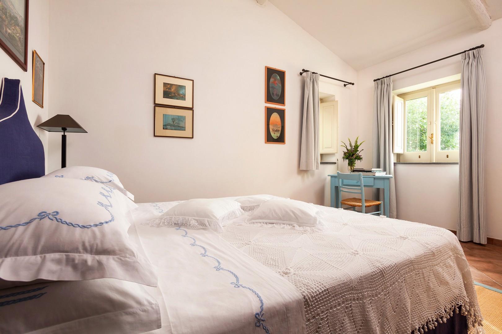 Cottage bedroom with en suite bathroom.