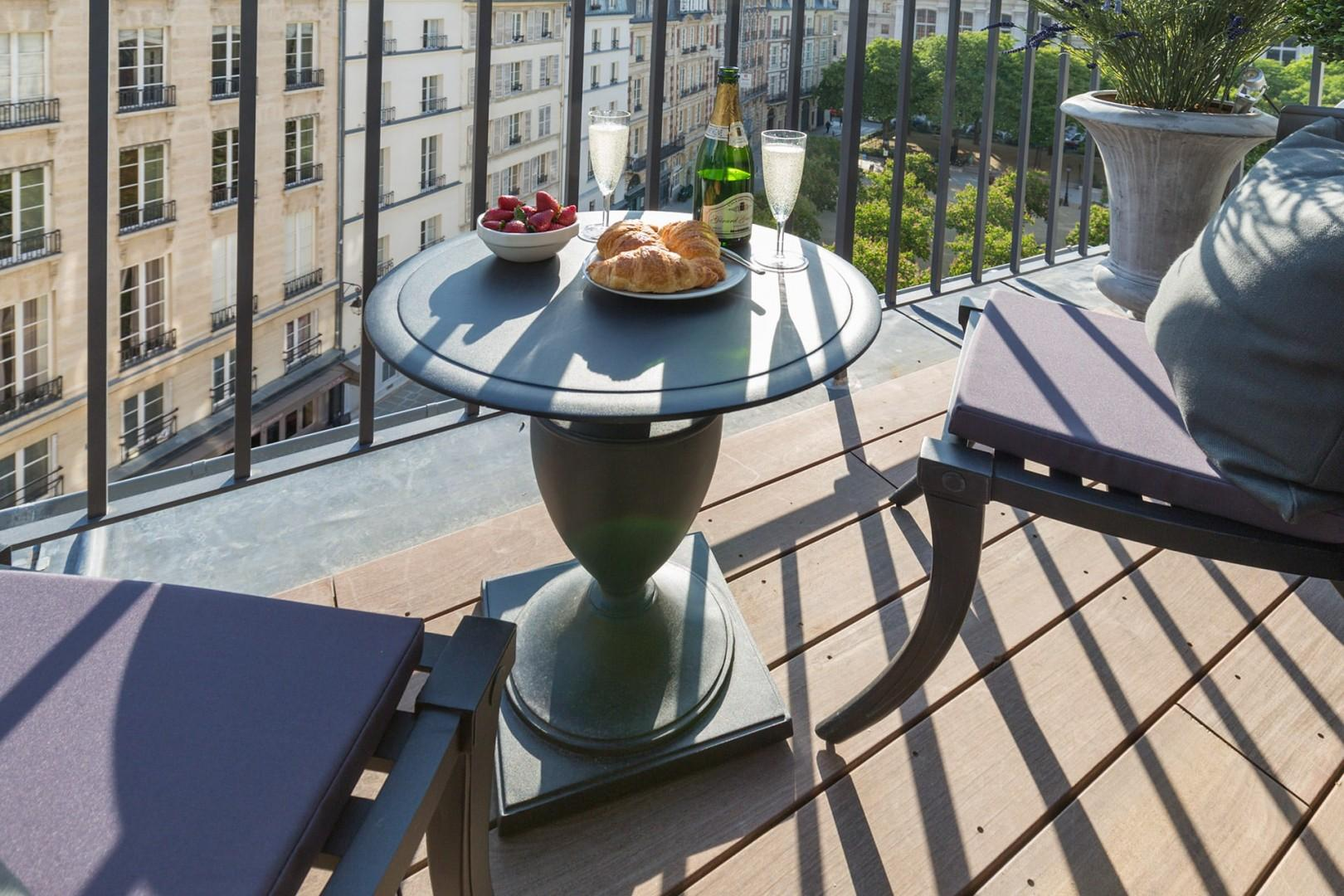 Enjoy your private balcony overlooking the lovely Place Dauphine.
