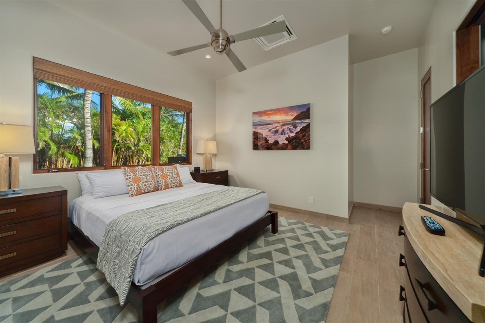 Guest bedroom suite 3 (downstairs) with Cal King bed, smart flat screen television and en suite bath.