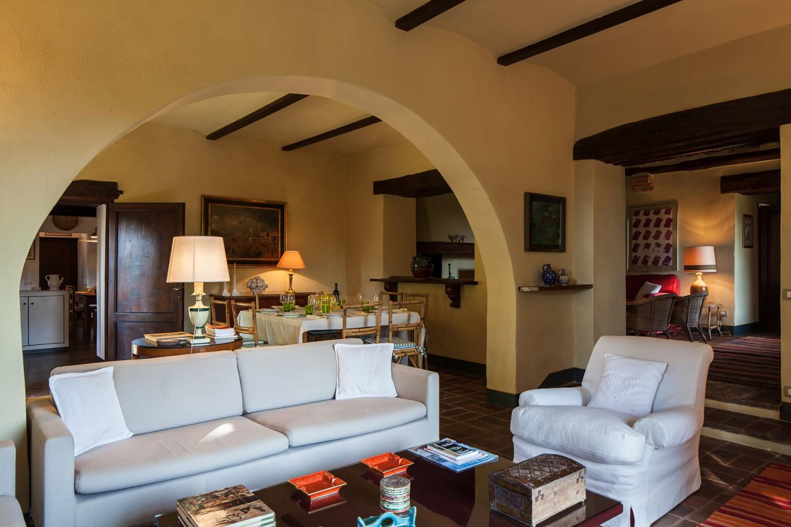 The living room of Albero is at the heart of the house and has windows that open onto the garden.