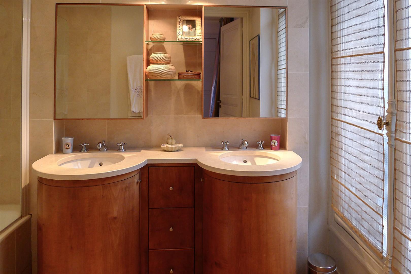 Enjoy the practical double sink in bathroom 2.