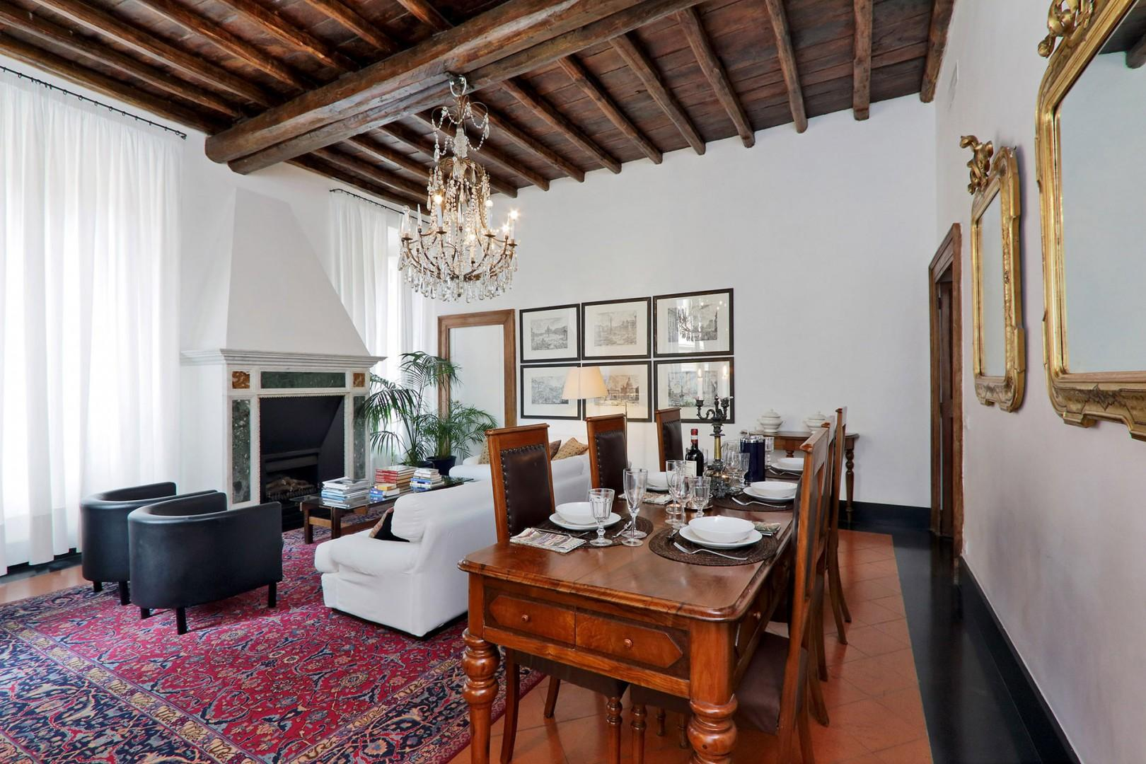 More views of the living room and dining area with lovely high beamed ceilings.