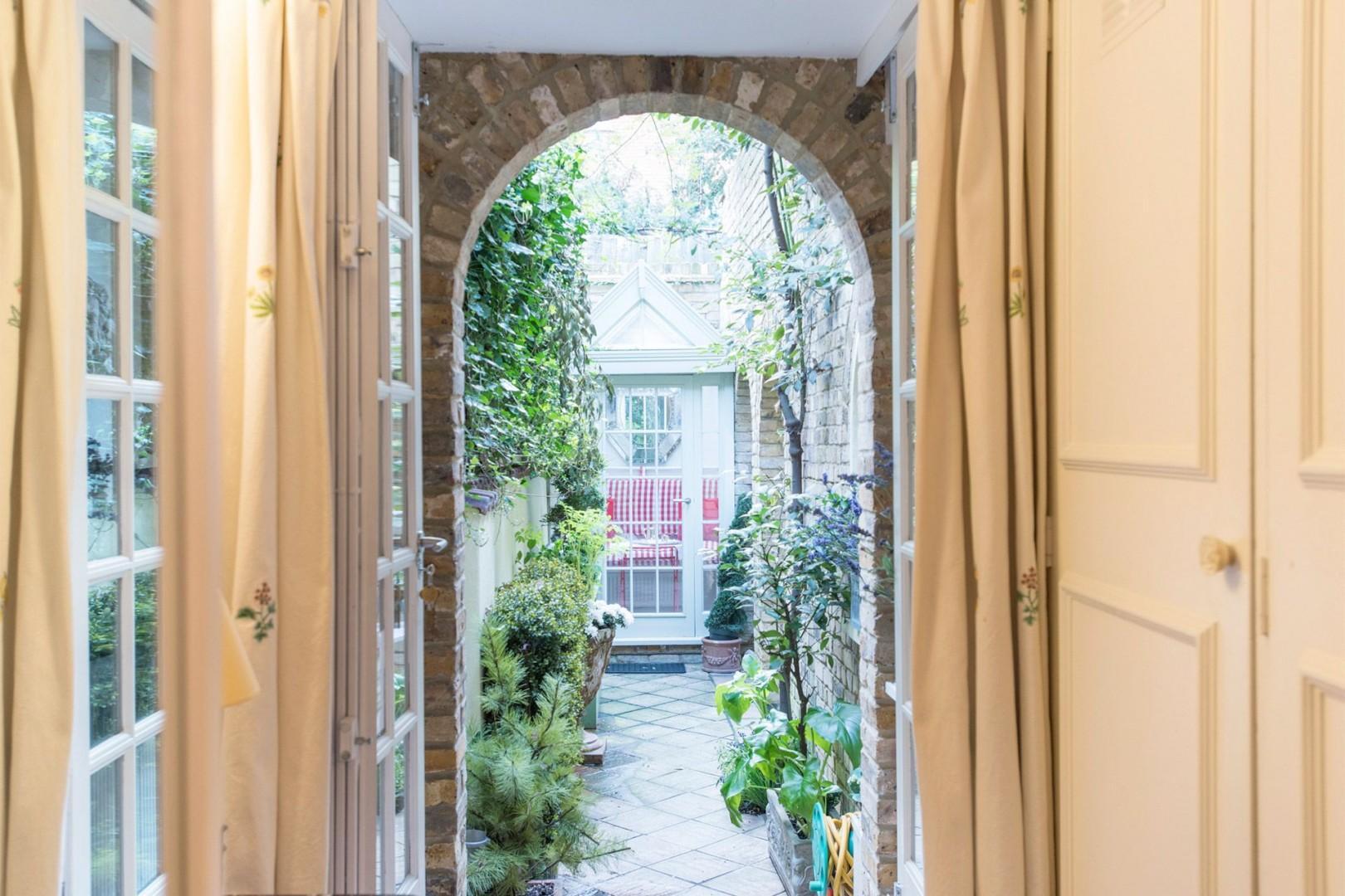 Corridor leading to bathroom, bedroom and private garden