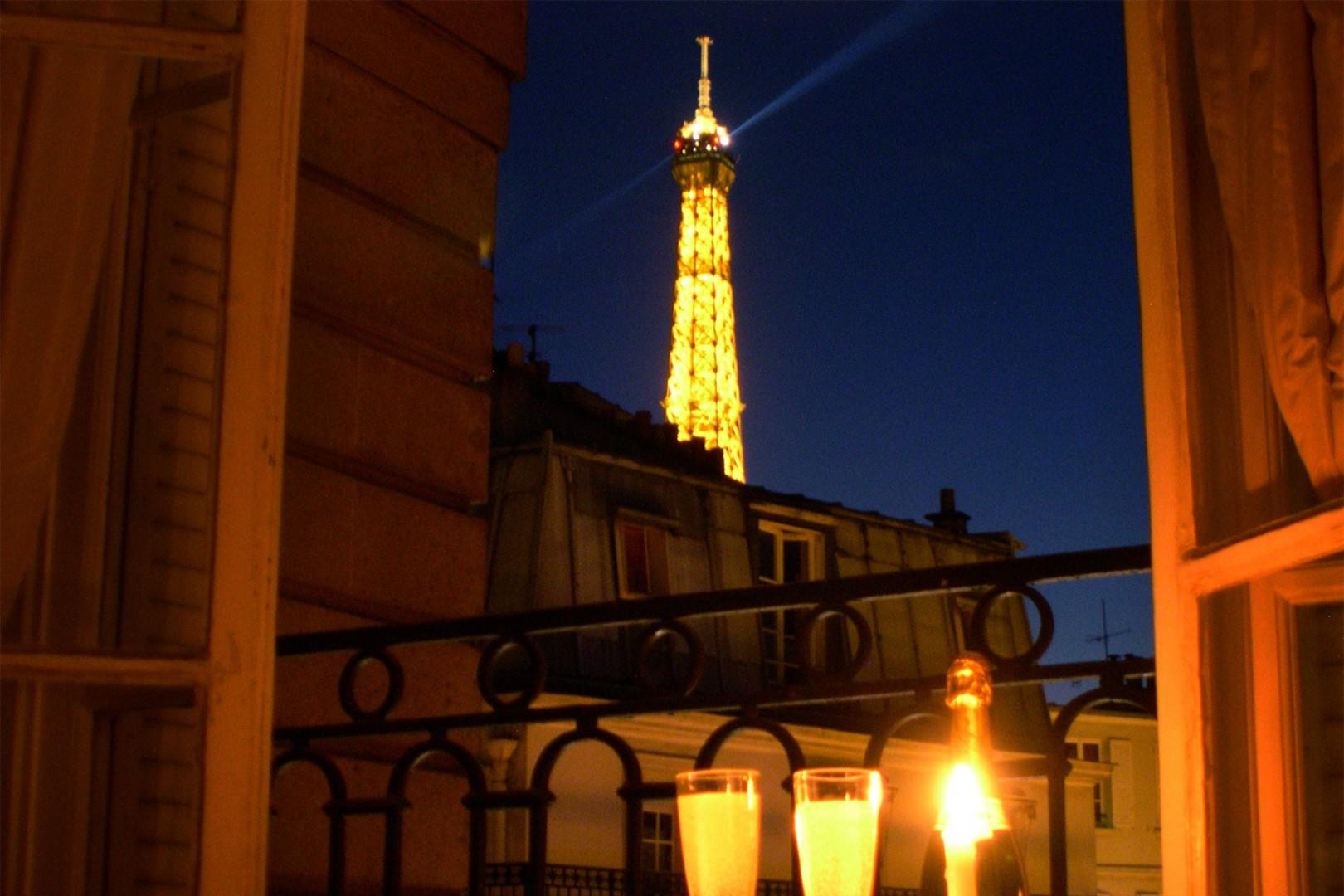 Watch the lights sparkle on the Eiffel Tower right from the apartment.