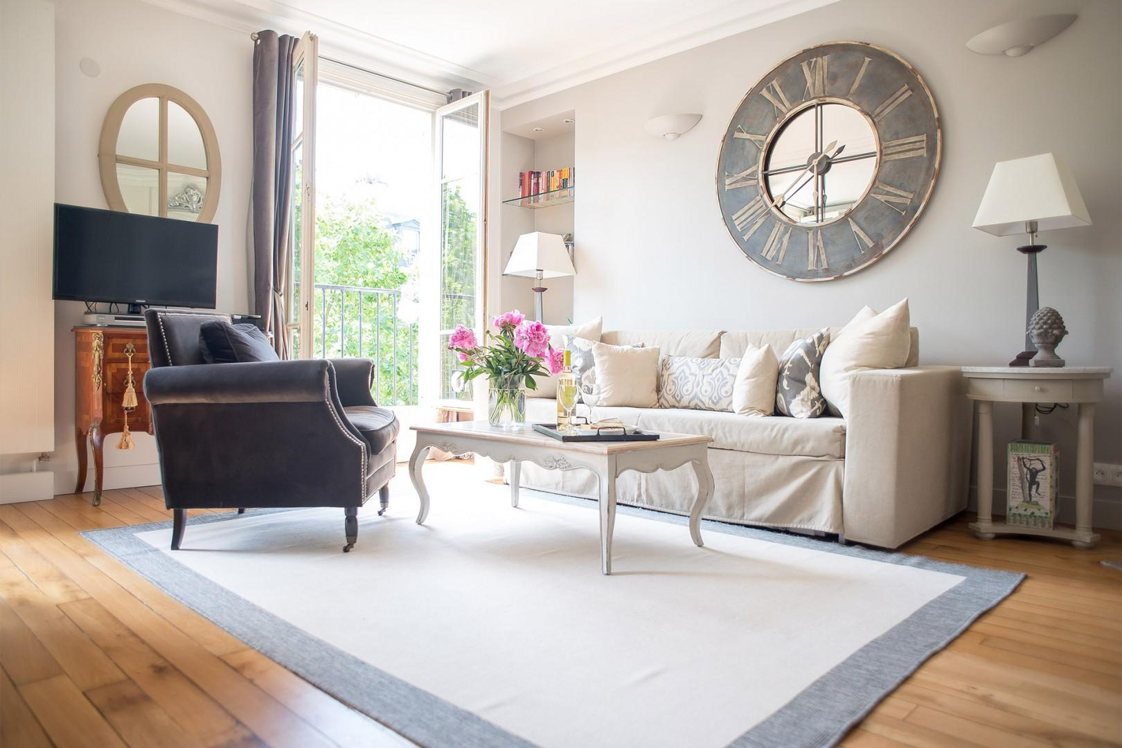 Relax in the bright and comfortable seating area in the living room.