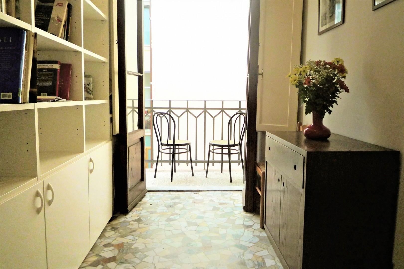 Hallway has a small balcony overlooking neighbors' gardens.