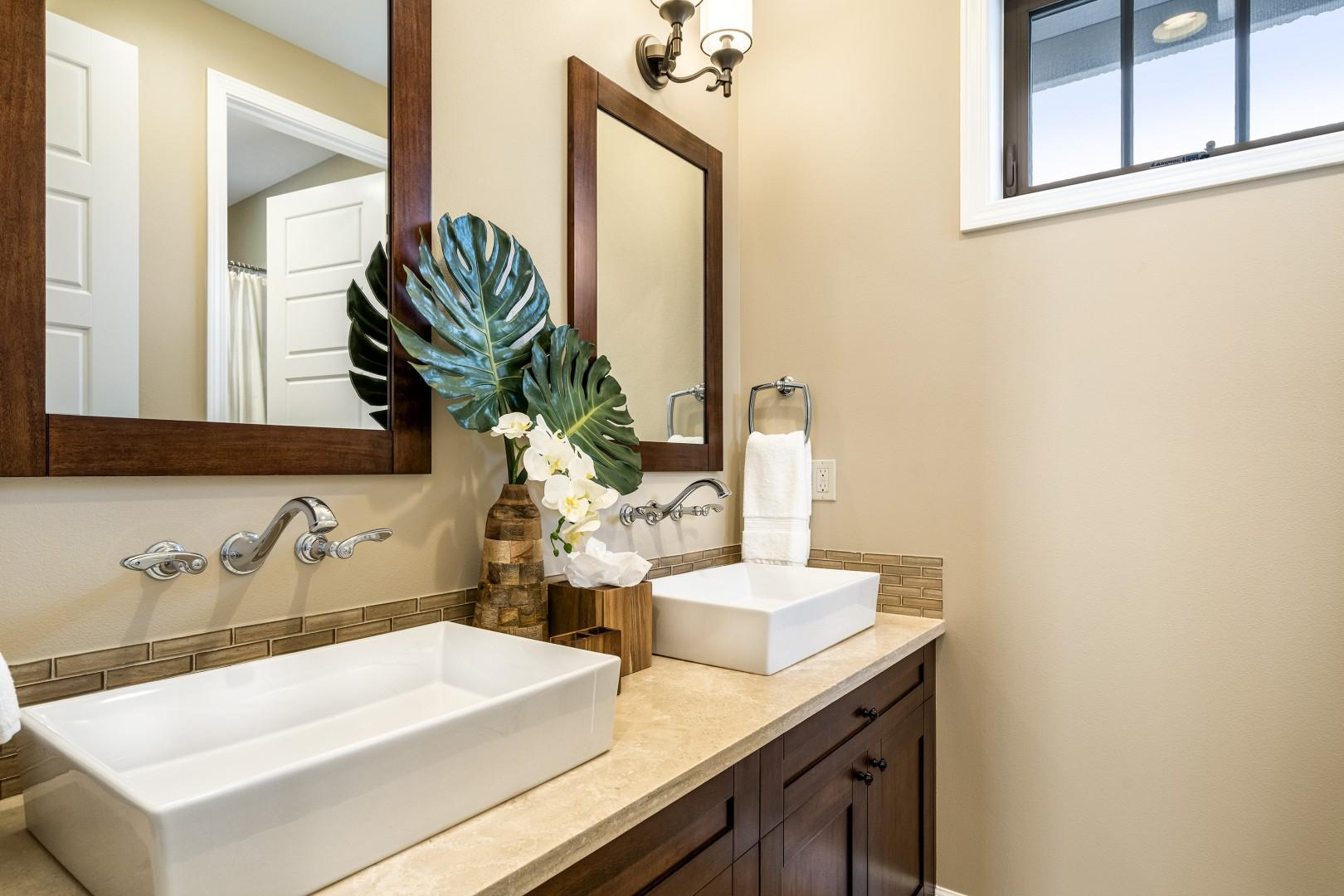 Upstairs guest bathroom, equipped with dual vanities